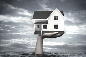 Illustrative image of hand coming out from sea holding model home representing home
