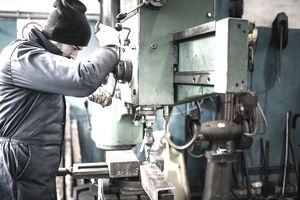 Worker operating heavy machinery in a zero waste landfill.