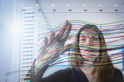 Woman looking at qualitative research graph