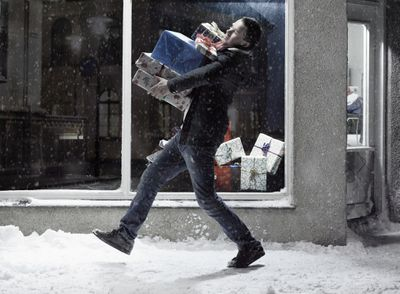 man carrying client gifts
