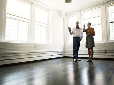 Realtor showing an empty loft to a renter.