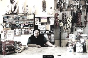 woman working at a wholesale merchandise shop in bodega