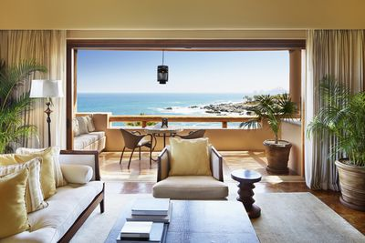 Luxury home with a balcony view of the ocean
