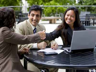 employees meeting outside for an interview after going through the 12-step checklist for hiring new employees