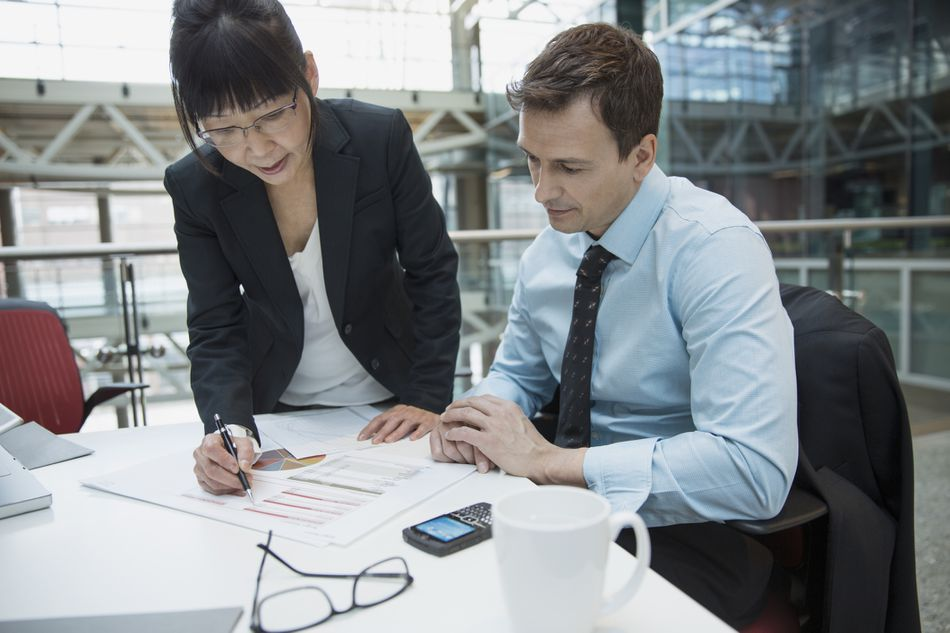 Business people reviewing company financial data in meeting