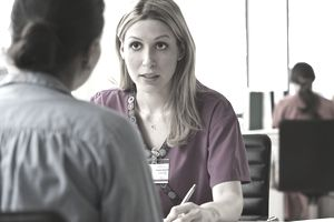 Nurse talking to a patient in an office