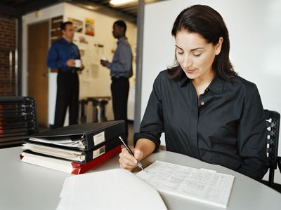Businesswoman filling out a franchise agreement
