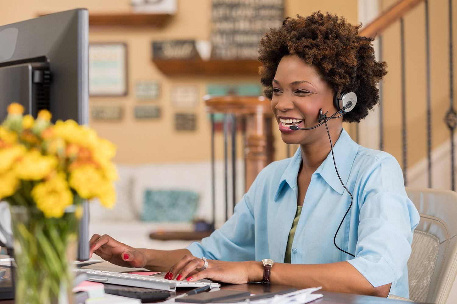 Temporary worker uses headset to talk to a client