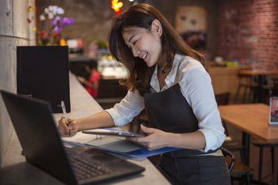 Cafe restaurant owner doing accounting and finances