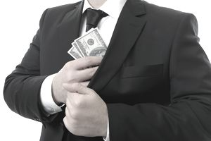 A man in a suit pockets some cash