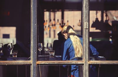 A woman sitting in a restaurant