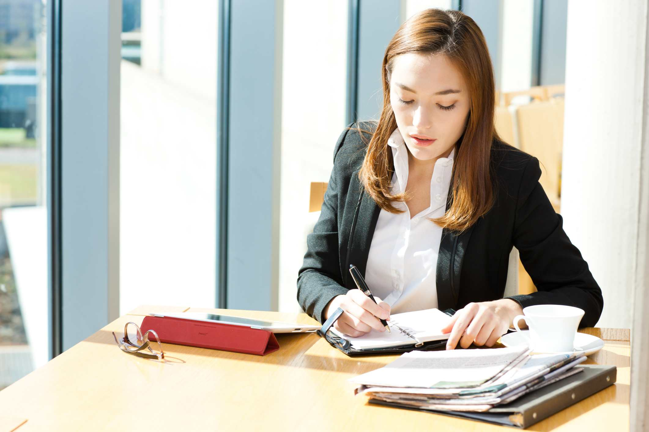 Woman writing in day planner