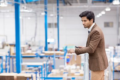 Businessman on factory balcony looking away