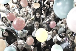 young business people celebrating at an office event