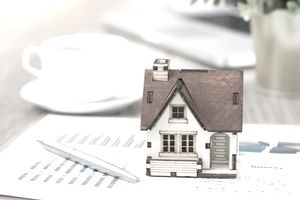 House price BPO concept with house, financial paper, and pen