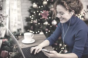 Holiday worker freelancer on laptop and phone