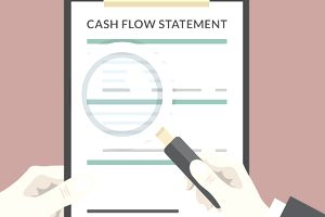 Hand holding cash flow statement clipboard