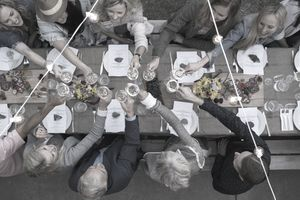 Overhead view of friends toasting at a retirement party