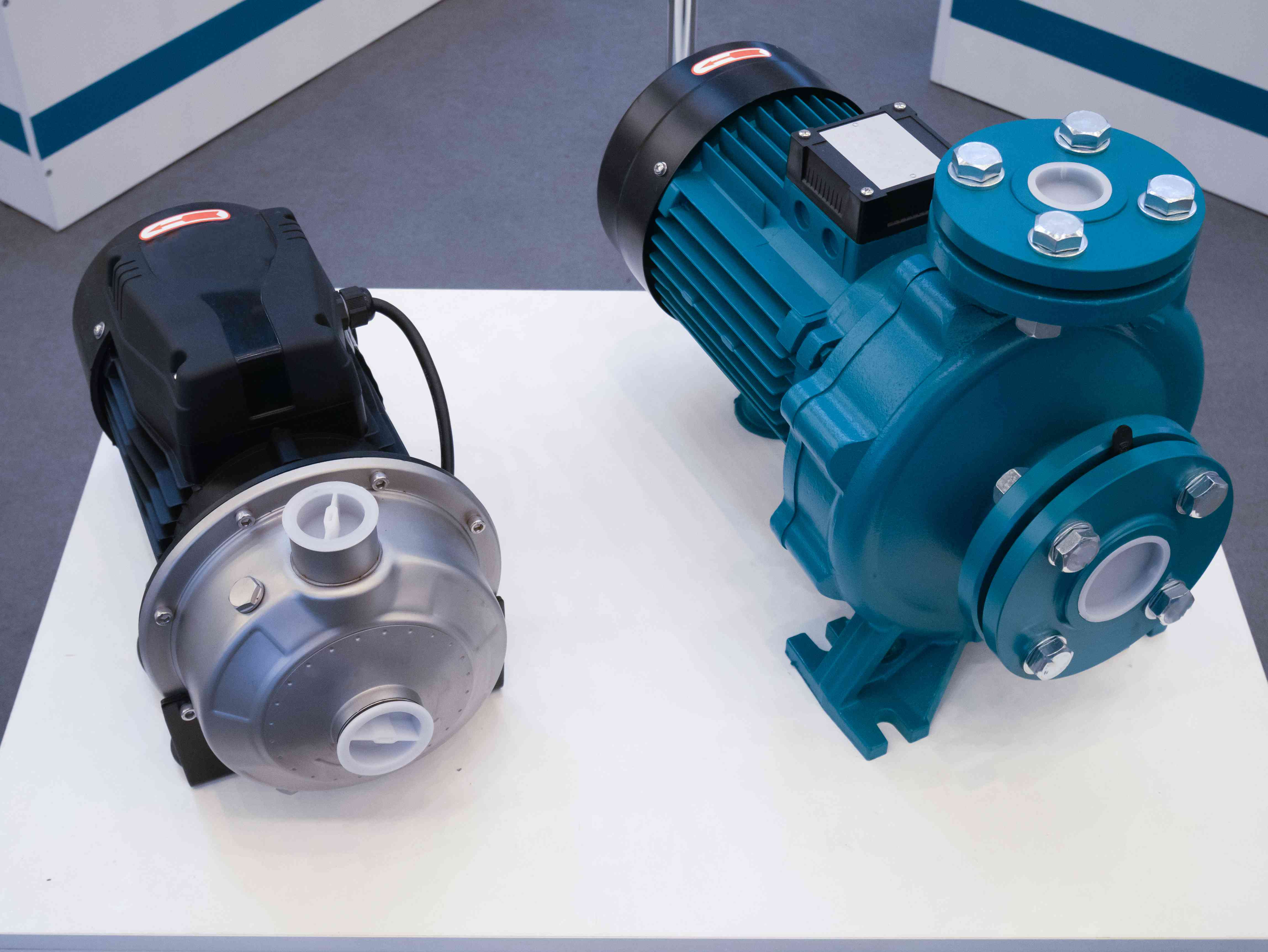 two electric motorized portable water pumps at hardware store