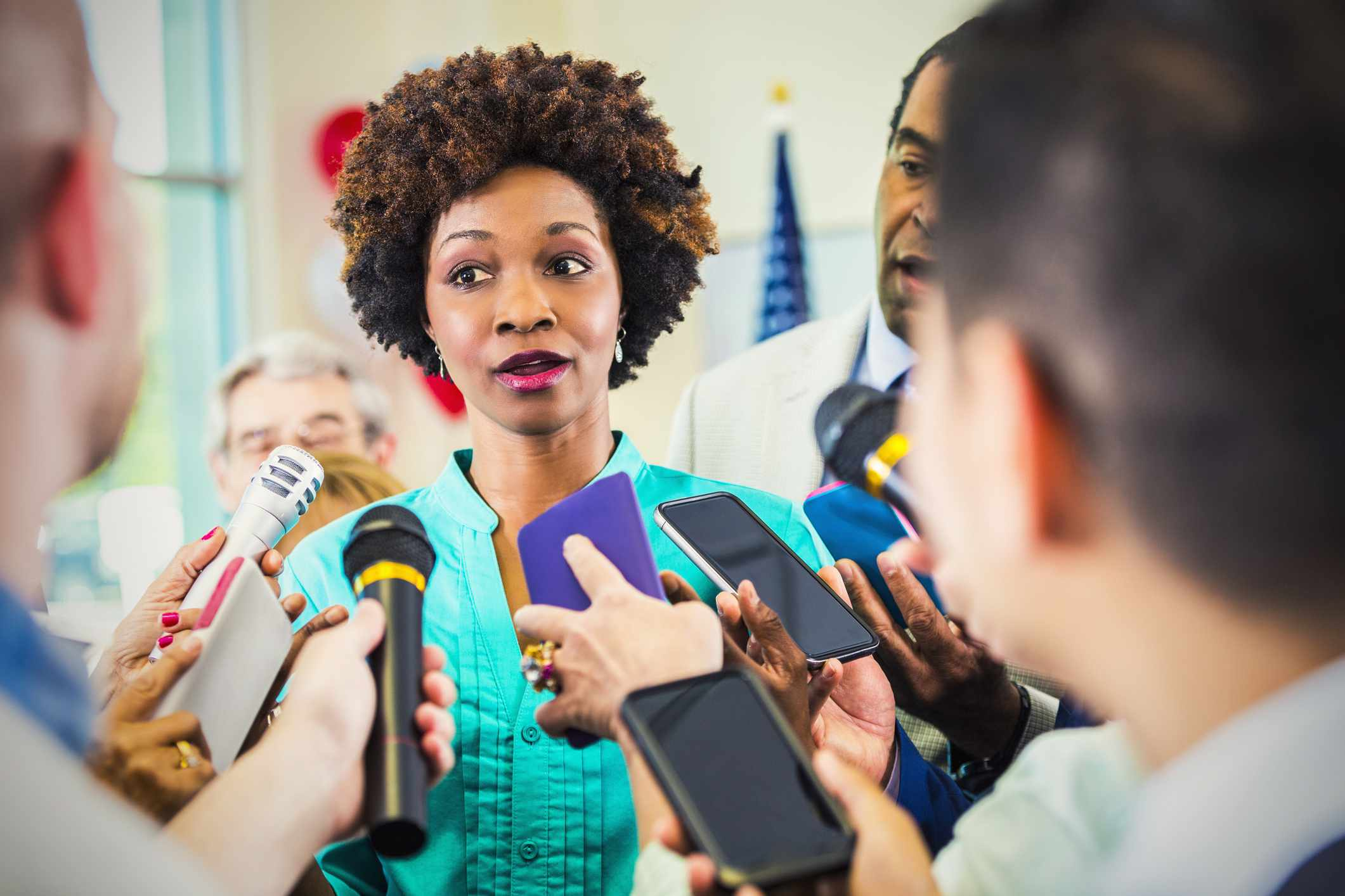 African American woman being interviewed by media.