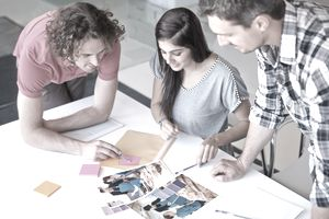 workers determining the creative strategy in a marketing advertisement