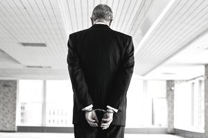 Businessman in handcuffs