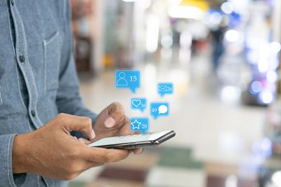 Hand touch screen smart phone. Application icons interface on screen. Social media concept