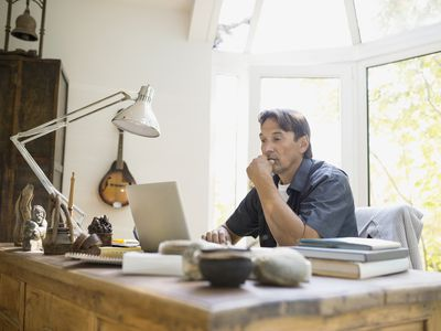 Man working at laptop in home office