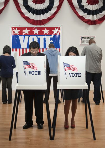 Voters voting at polling place