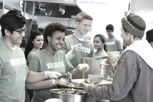 Coworkers volunteering at food kitchen after work