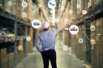 Supply chain manager looking at logistics in warehouse