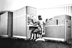 Woman operating an old fashioned computer, representing the concept of depreciation