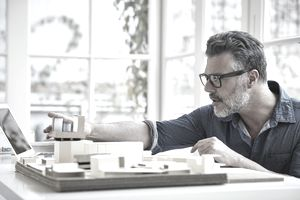 Architect working on model at desk