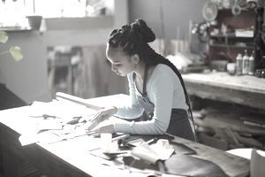 Craftswoman working in her shop