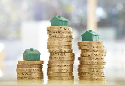 British pound coins with model houses