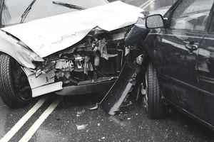 Two damaged cars after crash, close-up