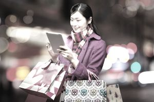 Woman shopping with tablet