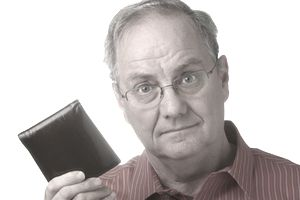 Older man holding up wallet.