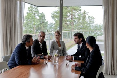 Board members having a meeting around a conference table