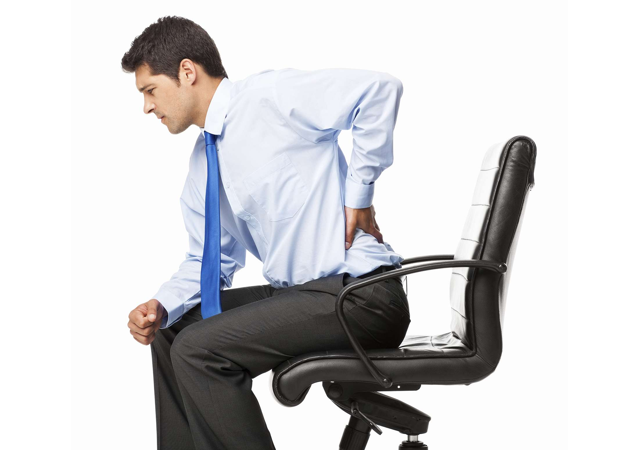 Man with back pain sitting on a small office chair