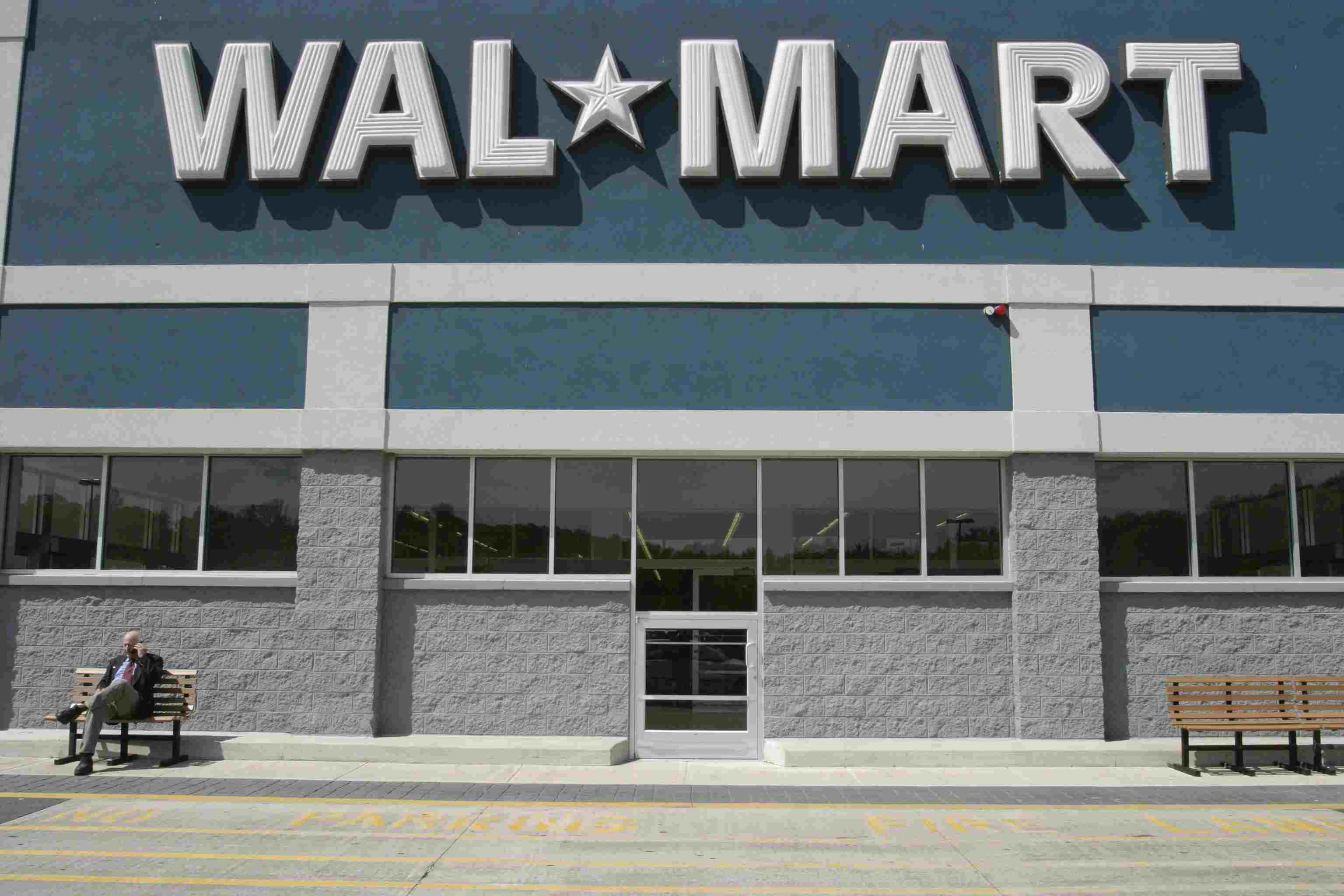 Businessman Talking on Cell Phone Outside Wal-Mart