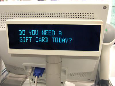Cash register gift card offer in department store