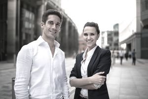 Two young business partners on a city street
