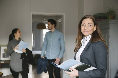 Realtor showing prospective clients a new home