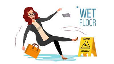 Woman in business clothes falling on a slippery floor
