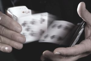 Hands performing card trick