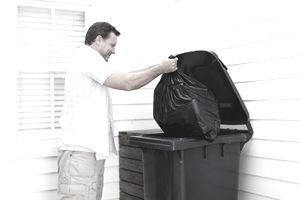Landlord disposing of garbage as part of his responsibilities.
