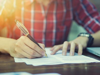 Small business owner signing a loan