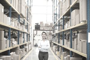 a young woman walking through a warehouse