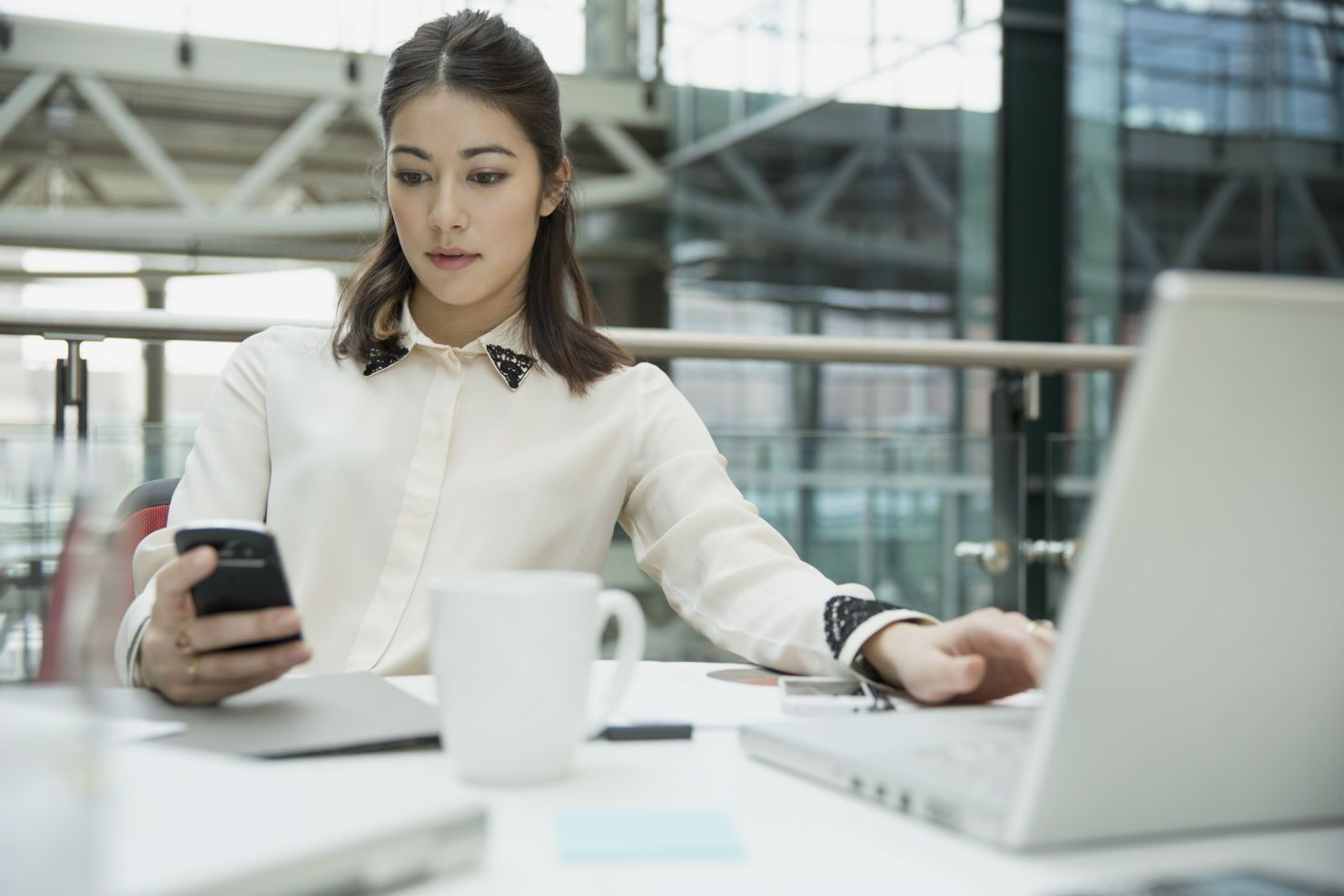 Business professional looking at smartphone